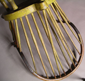 A Brace Back Continuous Arm Windsor Chair in Old Yellow Paint