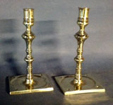 A Pair of Early Bold Saucer Base Candlesticks